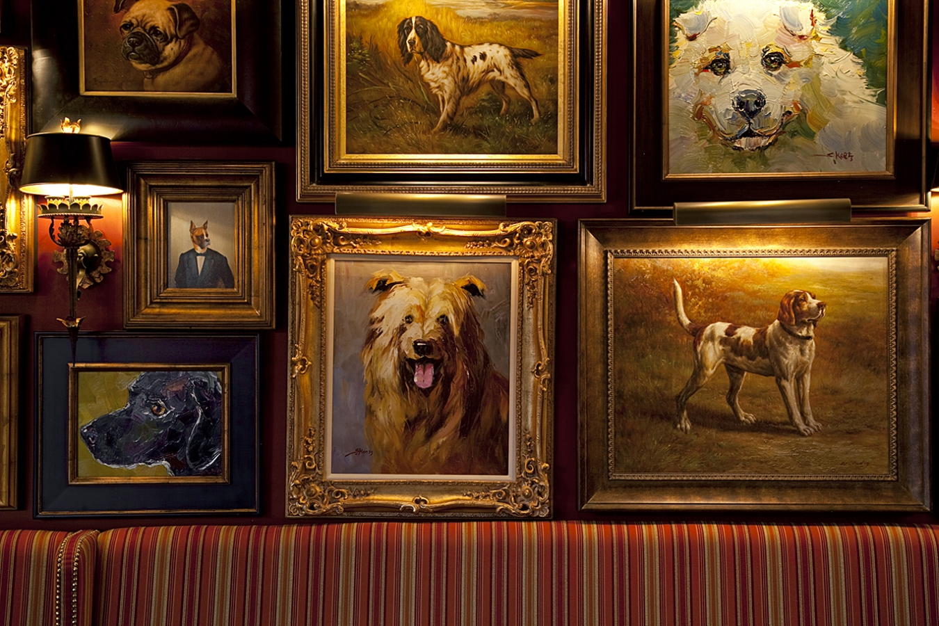 Dog portraits align the walls of White Dog Wayne